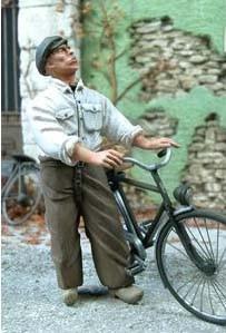 F050 Man holding a bike Image