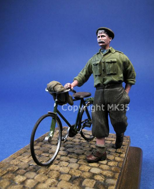 F252 Civilian pushing on his bike Image