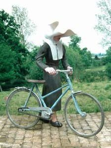 F139 Nun and her bicycle Image